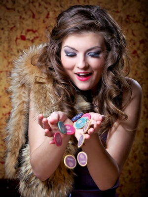 A woman wih a fur and casino chips